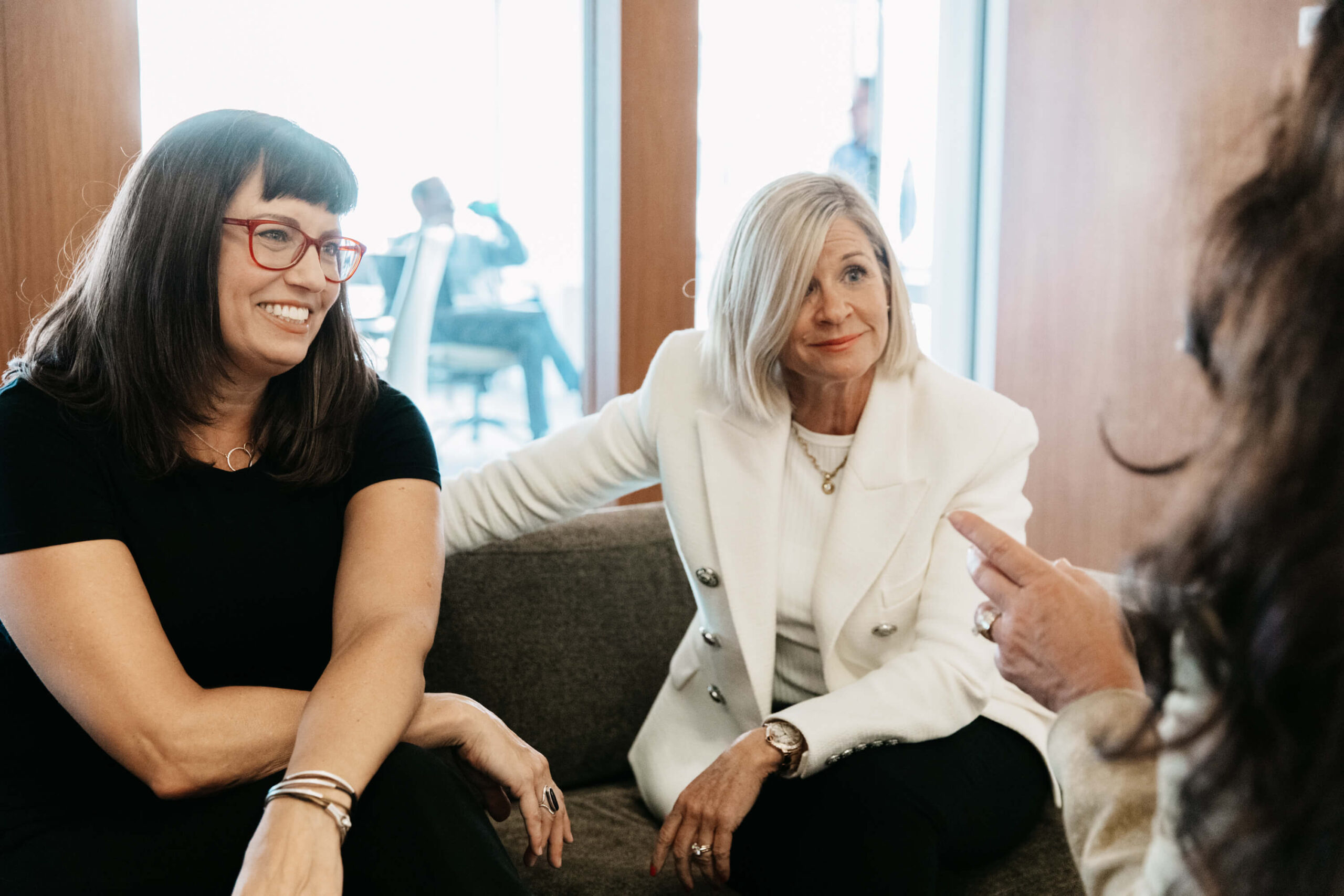 how we help - three women sitting on a couch and talking
